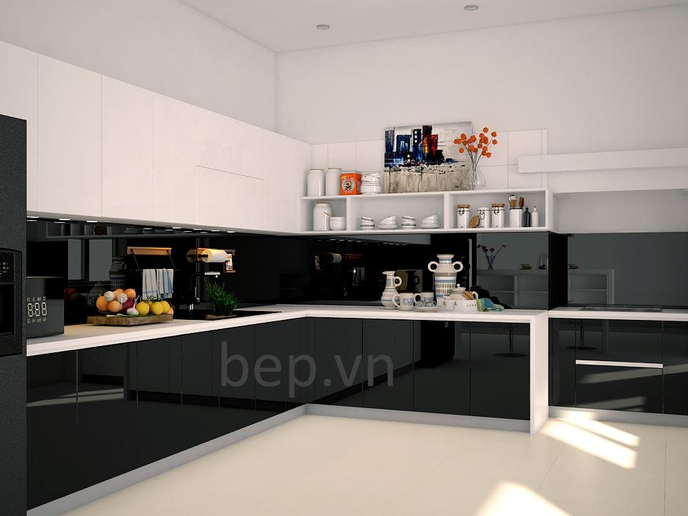 Tủ bếp màu đen mang lại sự sang trọng tuyệt đối tuy nhiên cũng là bài toán khó cho các KTS , Bep.vn sử dụng chất liệu Acrylic cho hệ thống tủ bếp dưới và tấm chắn bếp nhưng lại dùng đồng thời hệ tủ kín và tủ mở cho tủ trên . Điều này giúp không gian bếp có được sự thoáng đãng mà không bị ngột ngạt bởi màu đen.