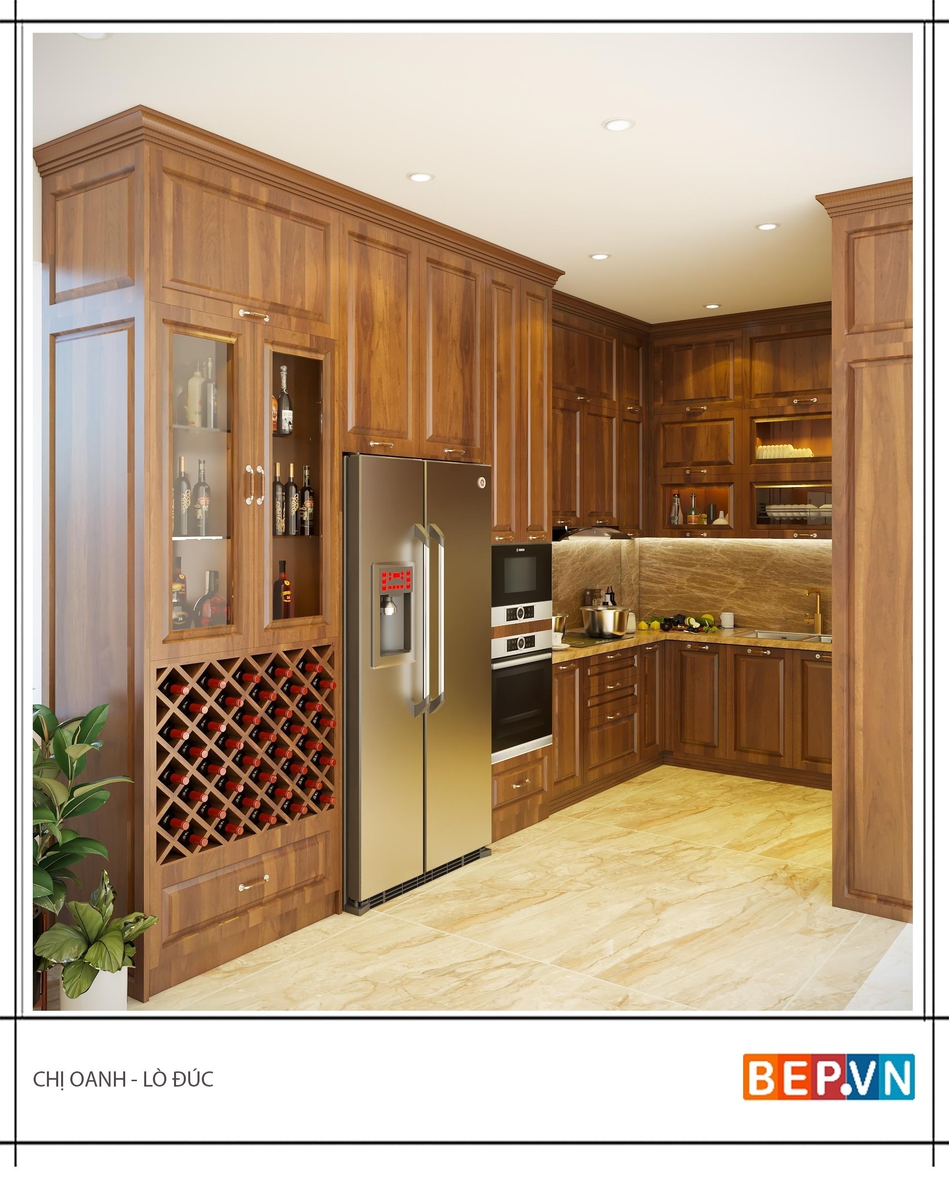 Thiết kế tủ bếp ốp trần chữ U sử dụng chất  liệu gỗ Hương ấm cúng và sang trọng.  Một thiết kế có tính thống nhất từ tủ bếp đến bàn đá và tường chắn bếp  đem lại giá trị thẩm mỹ cho toàn bộ không gian