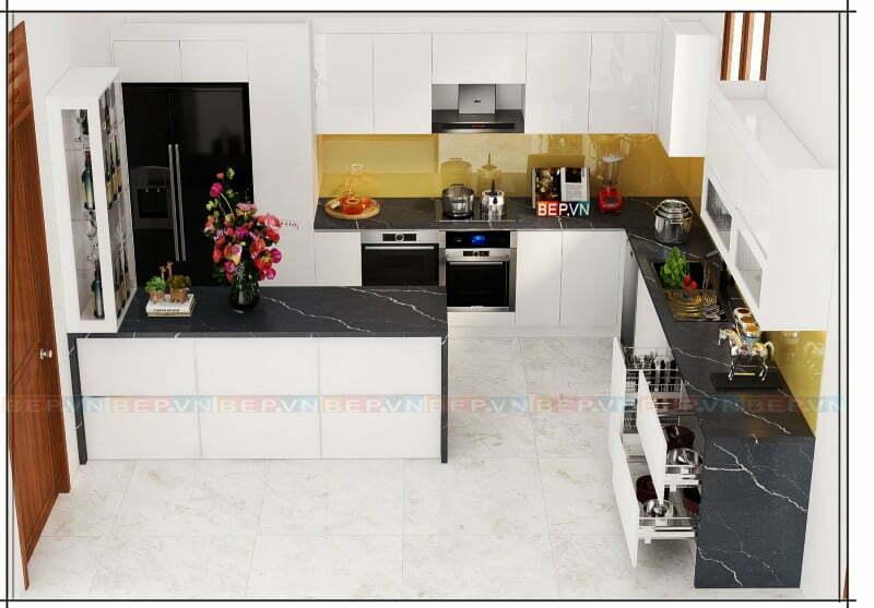 Mẫu tủ bếp đảo trắng với lựa chọn sử dụng đá marble đen nổi bật.