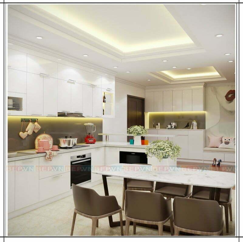 Không gian bếp đồng nhất từ tủ bếp đến bàn đá, gạch lát sàn , tường chắn bếp và bàn ăn...